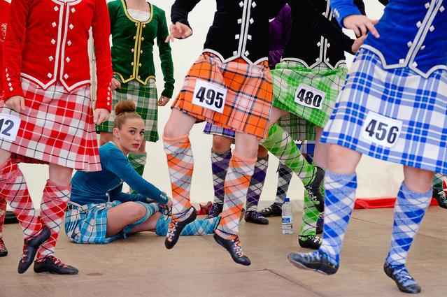 Dancers warm up before competing at the Cowal Highland Gathering on August 30, 2013 in Dunoon, Scotland. First held in 1894, the Cowal Games are held over three and are one of the largest in the world attracting competitors from Canada, USA, South Africa, Australia and New Zealand.  (Photo by Jeff J. Mitchell/Getty Images)