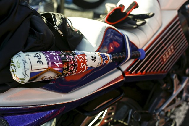 A baseball bat is strapped to the seat of a Bousouzoku style motorbike that is parked at the Dangouzaka rest stop in Yamanashi, west of Tokyo, Japan, January 3, 2016. (Photo by Thomas Peter/Reuters)