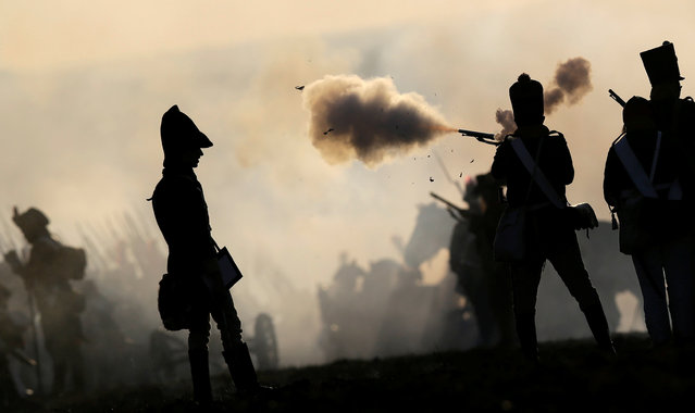History enthusiasts, dressed as soldiers, fight during the re-enactment of Napoleon's famous battle of Austerlitz near the southern Moravian town of Slavkov u Brna, Czech Republic December 3, 2016. (Photo by David W. Cerny/Reuters)