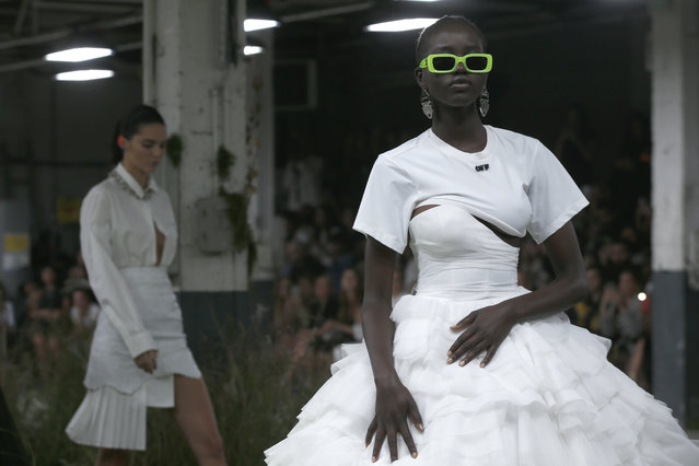 A model wears a creation for the Off White Spring/Summer 2019 ready to wear fashion collection presented in Paris, Thursday, September 27, 2018. (Photo by Thibault Camus/AP Photo)
