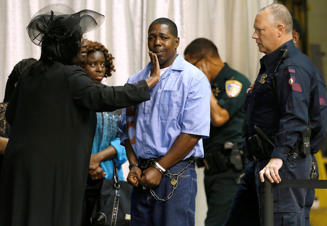An inmate with the Louisiana Department of Corrections is consoled by friends and family they attend the funeral of Alton Sterling, who was shot dead by police, in Baton Rouge, Louisiana, July 15, 2016. (Photo by Jonathan Bachman/Reuters)