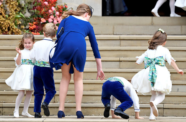 Princess Charlotte of Cambridge arrives with bridesmaids and pageboys for the royal wedding of Princess Eugenie and Jack Brooksbank at St George's Chapel in Windsor Castle, Windsor, Britain October 12, 2018. (Photo by Toby Melville/Reuters)