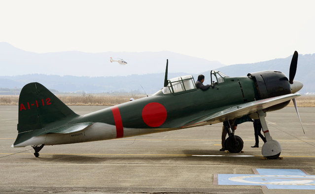 Mitsubishi's legendary Zero fighters is prepared for a test flight at an air station in Kanoya, Kagoshima prefecture, southern Japan, Wednesday, January 27, 2016. The restored plane took to the skies over Japan on Wednesday for the first time since World War II. (Photo by Hiroko Harima/Kyodo News via AP Photo)