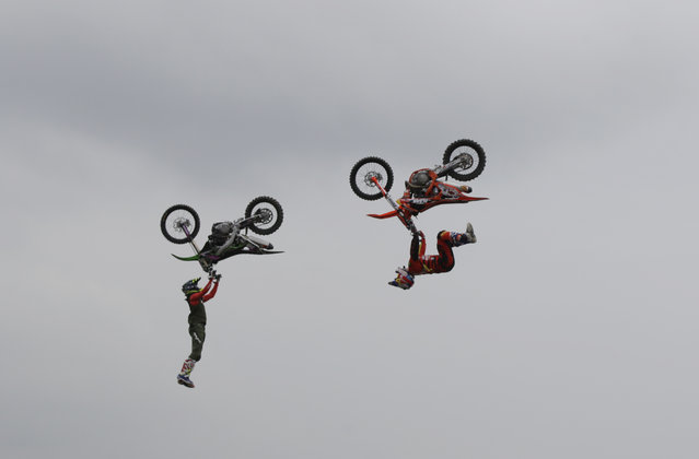 Riders perform during a freestyle motocross show at the EICMA exhibition motorcycle fair in Milan, Italy, Thursday, November 8, 2018. (Photo by Luca Bruno/AP Photo)