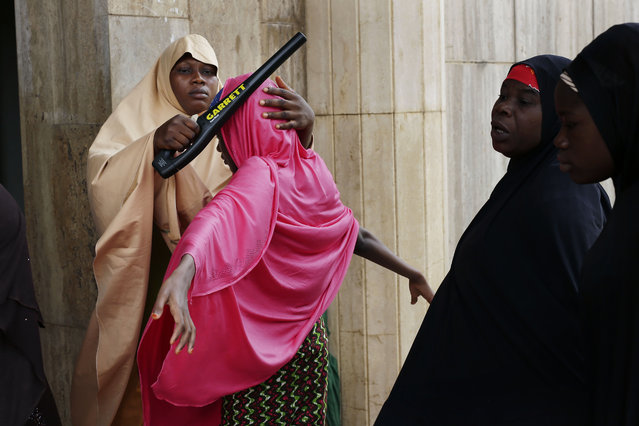 Nigerian women go through a security check as they enter the main mosque for Friday prayers in the capital Abuja, Nigeria Friday, March 27, 2015. Nigerians are due to go to the polls to vote in presidential elections on Saturday. (Photo by Jerome Delay/AP Photo)