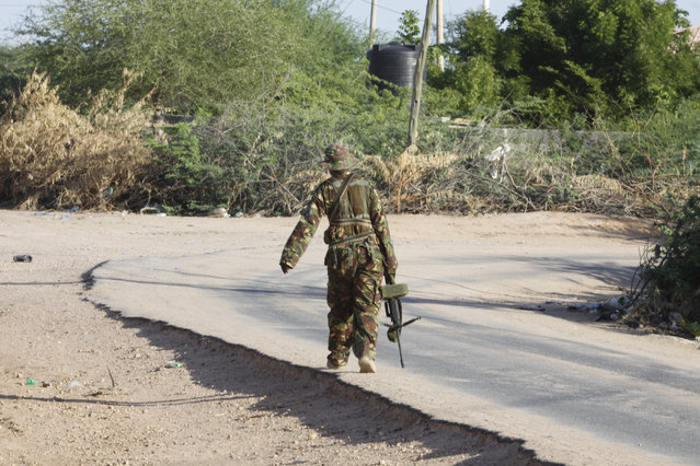 A member of Kenya Defence Forces patrols the area of the Garissa University college, in Garissa, Kenya, Thursday, April 2, 2015. (Photo by Khalil Senosi/AP Photo)