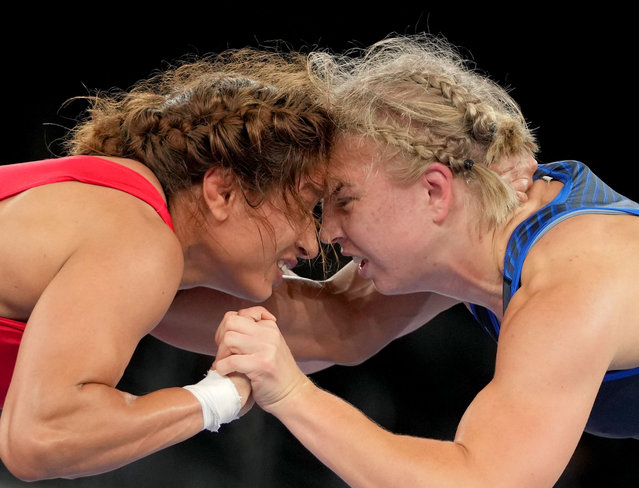 Henna Katarina Johansson (R) of Sweden competes with Marwa Amri of Turkey during the Wrestling Women's Freestyle 62kg 1/8 final at the Tokyo 2020 Olympic Games in Chiba, Japan, Aug. 3, 2021. (Photo by Xinhua News Agency/Rex Features/Shutterstock)