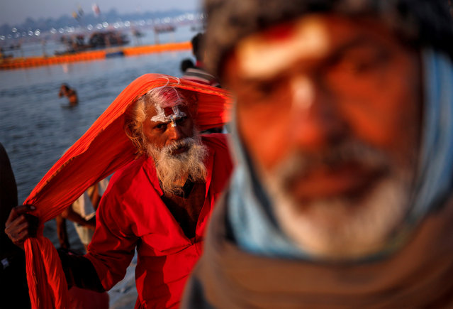 """Sadhus or Hindu holy men leave after taking a holy dip at Sangam, the confluence of the Ganges, Yamuna and Saraswati rivers, during """"Kumbh Mela"""", or the Pitcher Festival, in Prayagraj, previously known as Allahabad, January 16, 2019. (Photo by Danish Siddiqui/Reuters)"""