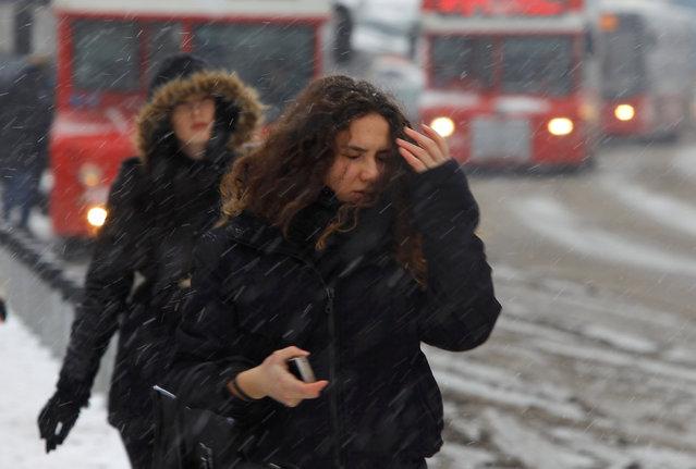 A woman walks in a snowstorm in Skopje, Macedonia January 10, 2017. (Photo by Ognen Teofilovski/Reuters)