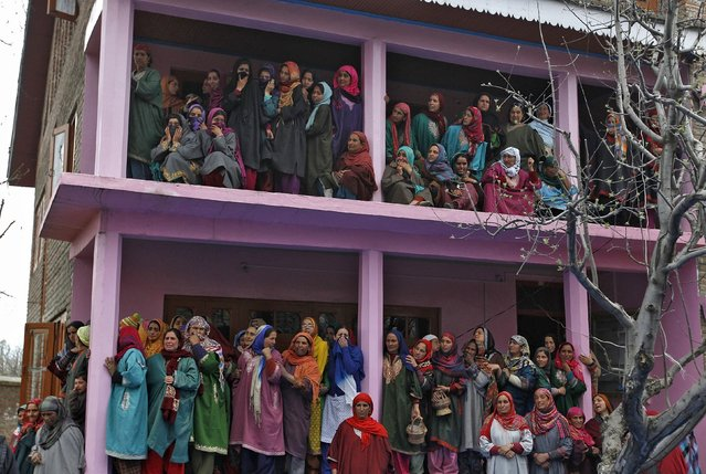 Kashmiri women weep as they watch the funeral procession of Mushatq Ahmad Wani, an Indian policeman, during his funeral in Arigam, south of Srinagar April 6, 2015. (Photo by Danish Ismail/Reuters)
