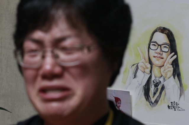 In this April 8, 2015, photo, Lee Keum-hui, mother of high school student, Cho Eun-hwa, shown in the illustration at right, a missing passenger onboard sunken ferry Sewol, is overcome with emotion as she is interviewed by The Associated Press in her daughter's room at their home in Ansan, South Korea. Cho Eun-hwa, 16,  was one of 304 people killed one year ago on Thursday, April 16 in the sinking of the ferry, and among nine whose bodies still have not been recovered. (Photo by Ahn Young-joon/AP Photo)