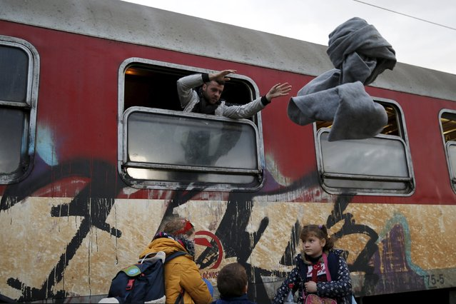 A migrant throws blankets from a train window as migrants are returned to a camp near the Macedonian-Greek border in Gevgelija, Macedonia, February 24, 2016. (Photo by Marko Djurica/Reuters)