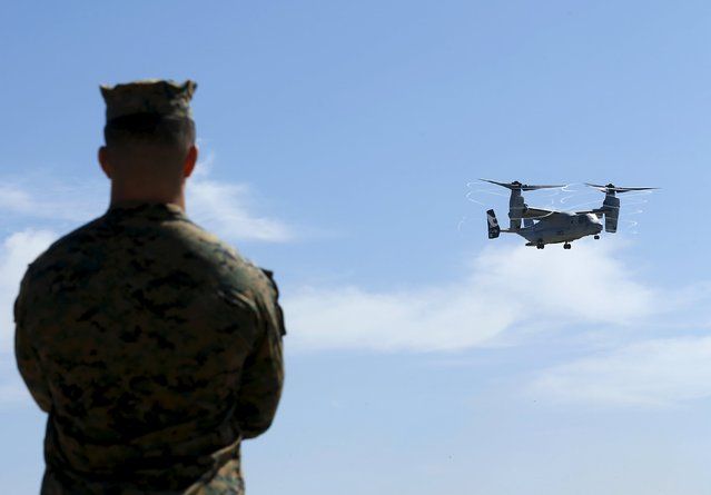 A U.S. Marine watches as an Osprey tilt-rotor aircraft takes off near the beach on Camp Pendleton, California February 26, 2016. (Photo by Mike Blake/Reuters)