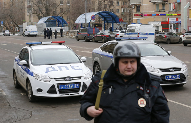 A Russian police officer stands at the site where a woman suspected of murdering a young child was detained, near Oktyabrskoye Pole metro station in Moscow, Russia, February 29, 2016. Russian investigators said on Monday they had arrested a nanny and charged her with murdering a young child in her care after local media broadcast footage of a woman brandishing a severed head near a busy Moscow metro station. (Photo by Maxim Zmeyev/Reuters)