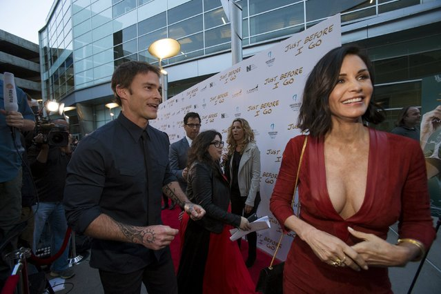 "Director of the movie Courteney Cox (R) and cast member Seann William Scott attend the premiere of ""Just Before I Go"" in Los Angeles, California April 20, 2015. The movie opens in the U.S. on April 24. (Photo by Mario Anzuoni/Reuters)"