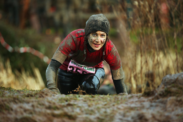 A competitor  climbs a muddy bank during the Tough Guy Challenge on January 26, 2014 in Telford, England.  (Photo by Bryn Lennon/Getty Images)