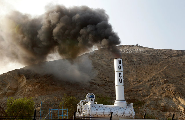 An incinerator expels smoke during the incineration of about 7.9 tons of drugs, seized during police operations, according to the Interior Ministry, in Lima, Peru February 2, 2017. (Photo by Guadalupe Pardo/Reuters)