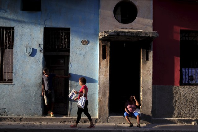Cubans are seen on a street in Havana March 9, 2016. March 8, 2016. (Photo by Enrique de la Osa/Reuters)