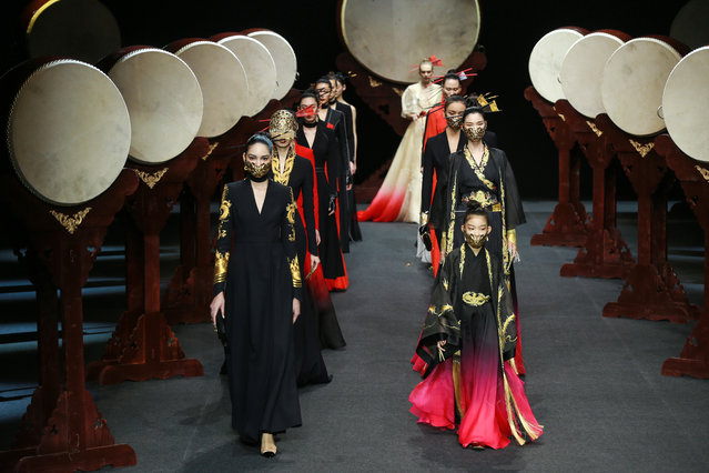 "Models display creations from the ""Heaven Gaia"" collection by Xiong Ying during the China Fashion Week in Beijing on March 31, 2019. (Photo by AFP Photo/Stringer)"