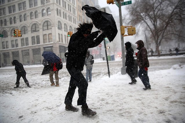 A man braces his umbrella while walking through the snow in New York City. Heavy snow and high winds made for a hard morning commute in the city. (Photo by John Moore/Getty Images)