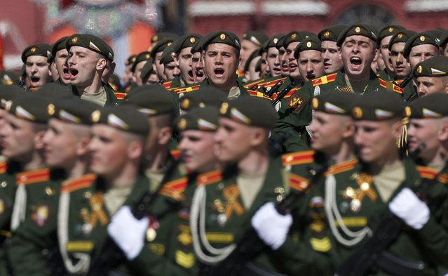 Russian army soldiers march along the Red Square during a general rehearsal for the Victory Day military parade which will take place at Moscow's Red Square on May 9 to celebrate 70 years after the victory in WWII, in Moscow, Russia, Thursday, May 7, 2015. (Photo by Ivan Sekretarev/AP Photo)