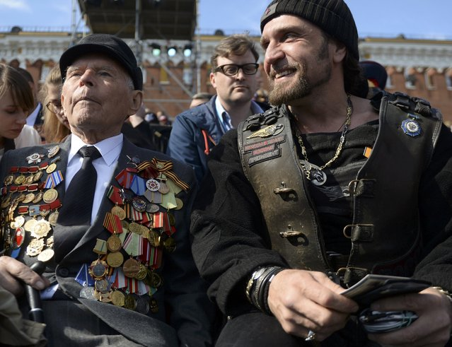 "Leader of the motorcycling club Night Wolves Alexander Zaldostanov (R), nicknamed ""Khirurg"" (Surgeon), and veteran wait for the Victory Day parade at Red Square in Moscow, Russia, May 9, 2015. (Photo by Reuters/Host Photo Agency/RIA Novosti)"
