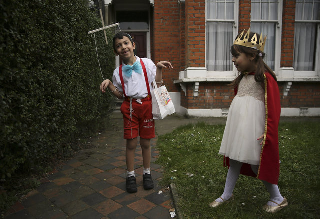 Children from the Jewish community dressed in costumes celebrate the festival of Purim in Stamford Hill in north London, Britain March 24, 2016. (Photo by Neil Hall/Reuters)