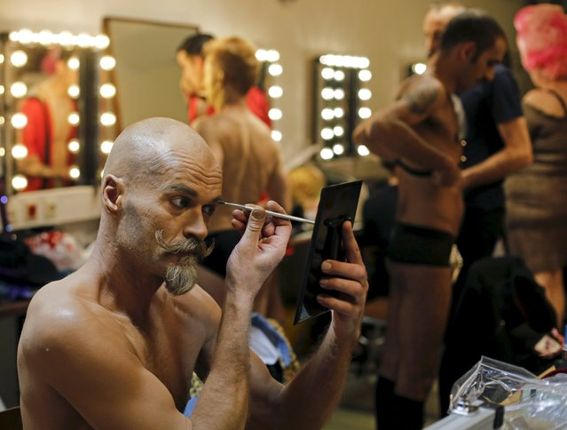 "A boylesque performer prepares before the ""Yodeling Lederhosen Boylesque Gala"" at the Boylesque Festival in Vienna, Austria, May 15, 2015. Picture taken May 15, 2015. (Photo by Leonhard Foeger/Reuters)"