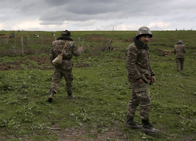 Soldiers of the self-defense army of Nagorno-Karabakh gather at their positions in Martakert province, which according to Armenian media was affected by clashes over the breakaway Nagorno-Karabakh region, April 4, 2016. (Photo by Vahan Stepanyan/Reuters/PAN Photo)
