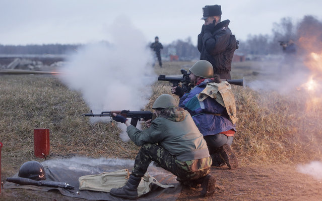 Self-Defense activists perform military exercises at a military training ground outside Kiev, Ukraine, Monday, March 17, 2014. Ukraine's parliament on Monday voted partial mobilization in response to Russia's invasion onto the Ukrainian territory. (Photo by Efrem Lukatsky/AP Photo)