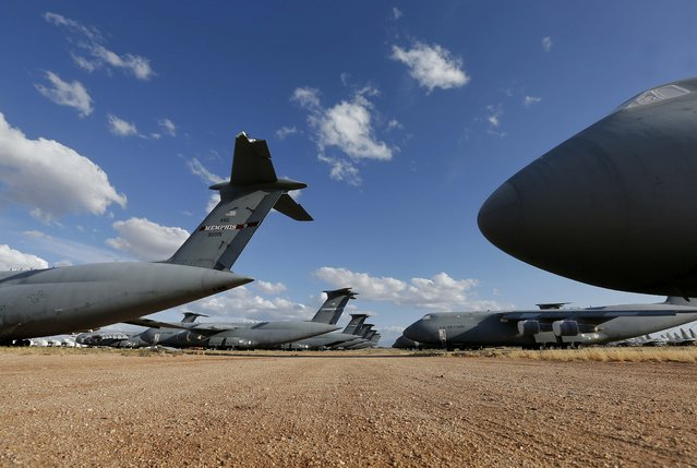 Lockheed C-5 Galaxy cargo jets line the fields at the 309th Aerospace Maintenance and Regeneration Group boneyard at Davis-Monthan Air Force Base in Tucson, Ariz. on Thursday, May 14, 2015. The C-5A Galaxy is the largest aircraft in the U.S. armed services and the C-5 series has been used by the Air Force continually since 1969. (Photo by Matt York/AP Photo)