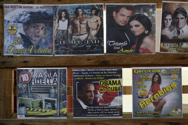 A DVD production called Obama in Cuba is displayed for sale alongside pirated CDs in Havana April 15, 2016. (Photo by Enrique de la Osa/Reuters)