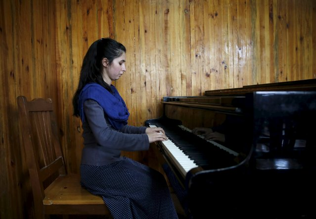 Negin Ekhpulwak, leader of the Zohra orchestra, an ensemble of 35 women, practises on a piano at Afghanistan's National Institute of Music, in Kabul, Afghanistan April 9, 2016. (Photo by Ahmad Masood/Reuters)