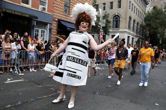 """A participant wears a """"Mueller report"""" dress in the 2019 World Pride NYC and Stonewall 50th LGBTQ Pride parade in New York, U.S., June 30, 2019. (Photo by Brendan McDermid/Reuters)"""