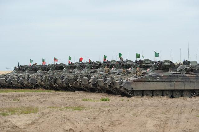 German army tanks are lined up after the NATO Noble Jump exercise on a training range near Swietoszow Zagan, Poland, Thursday, June 18, 2015. (AP Photo/Alik Keplicz)