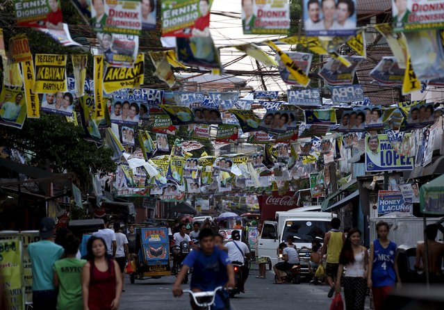 Election posters for May 2016 national elections hang above a busy road in Tondo, Manila in the Philippines April 26, 2016. (Photo by Erik De Castro/Reuters)