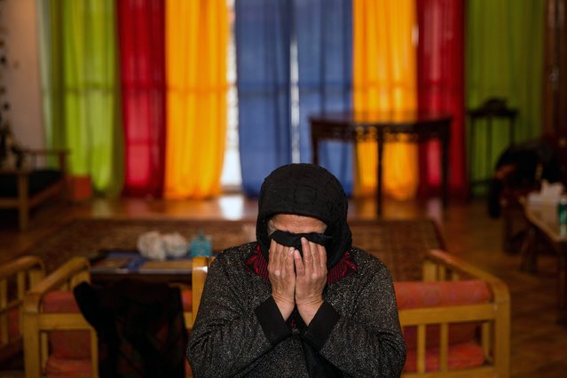 The mother of Iranian national named Balal (C), who killed fellow Iranian youth Abdolah Hosseinzadeh in a street fight with a knife in 2007, cries in her home ahead of his execution ceremony in the northern city of Nowshahr on April 15, 2014. The mother of  Abdolah Hosseinzadeh spared the life of Balal, her son's convicted murderer, with an emotional slap in the face as he awaited execution prior to removing the noose around his neck. (Photo by Araash Khamooshi/AFP Photo/ISNA)
