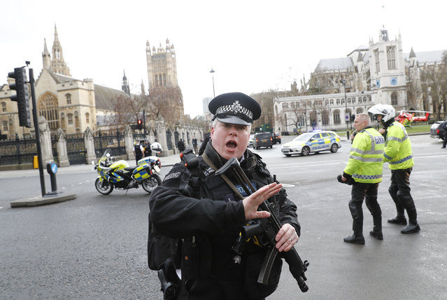 Armed police respond outside Parliament during an incident on Westminster Bridge in London, Britain on Wednesday, March 22, 2017. (Photo by Stefan Wermuth/Reuters)