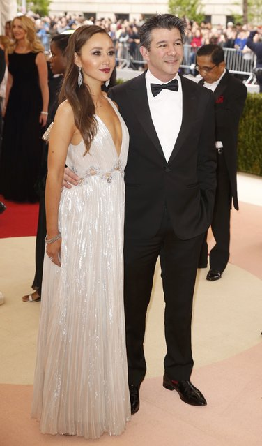 """Uber CEO Travis Kalanick and companion Gabi Holzwarth arrive at the Metropolitan Museum of Art Costume Institute Gala (Met Gala) to celebrate the opening of """"Manus x Machina: Fashion in an Age of Technology"""" in the Manhattan borough of New York, May 2, 2016. (Photo by Lucas Jackson/Reuters)"""