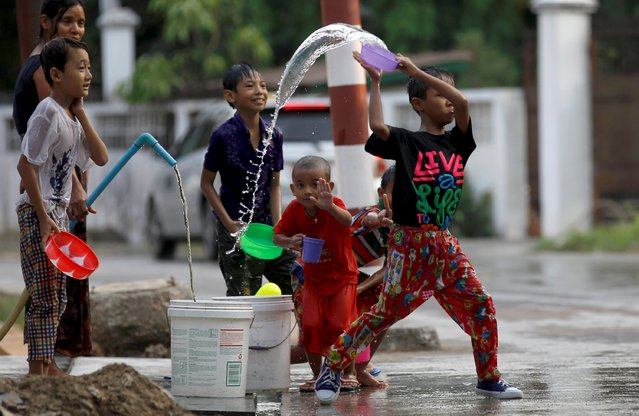 Boys play with water as they celebrate Myanmar's New Year Water Festival of Thingyan in Yangon, April 13, 2016. (Photo by Soe Zeya Tun/Reuters)