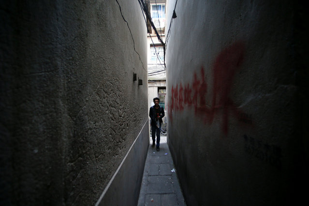 A man walks between houses at Guangfuli neighbourhood in Shanghai, China, April 19, 2016. (Photo by Aly Song/Reuters)