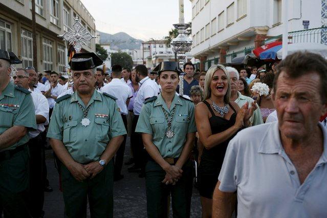 Spanish Civil guards take part in the procession of the El Carmen Virgin being carried into the sea in Malaga July 16, 2015. (Photo by Jon Nazca/Reuters)