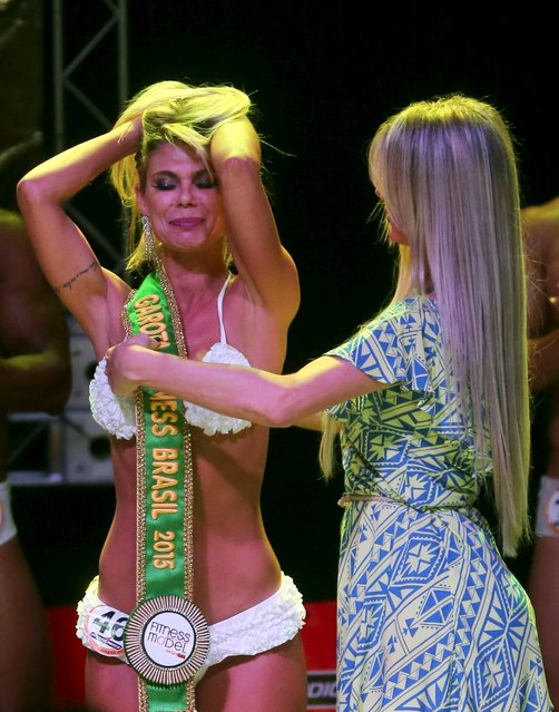 Tereza Pereira (L) reacts after winning the 2015 Brazil Miss and Mister Fitness contest in Sao Paulo, Brazil, June 18, 2015. (Photo by Paulo Whitaker/Reuters)