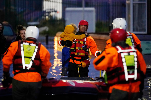 A young child is rescued from their home by a crew from South Yorkshire Fire and Rescue Service after severe flooding on November 08, 2019 in Doncaster, United Kingdom. Parts of northern England endured a month's worth of rain in 24 hours, causing severe flooding. (Photo by Christopher Furlong/Getty Images)