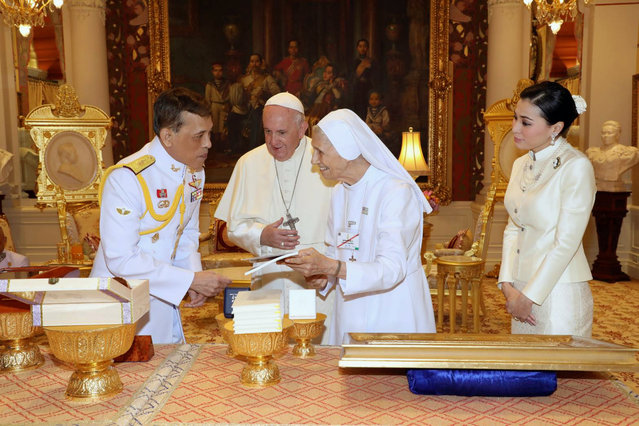 In this photo released by The Royal Household Bureau, Thai King Maha Vajiralongkorn talk to Pope Francis, his cousin Ana Rosa Sivori, and Thai Queen Suthida at Dusit Palace Thursday, November 21, 2019, in Bangkok, Thailand.(Photo by The Royal Household Bureau via AP Photo)