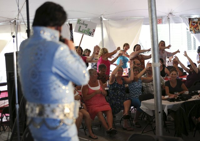 Elvis Presley tribute artist Gordie McNeil of Fort Erie, Ontario performs to dancing fans during the four-day Collingwood Elvis Festival in Collingwood, Ontario July 25, 2015. (Photo by Chris Helgren/Reuters)