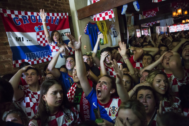 Croatian fans react to a penalty awarded to Brazilian player Neymar during the opening soccer match of the 2014 World Cup in the Astoria neighborhood of Queens, New York June 12, 2014. The neighborhood houses large Croatian and Brazilian communities and both countries met in the tournament's opening game. (Photo by Andrew Kelly/Reuters)