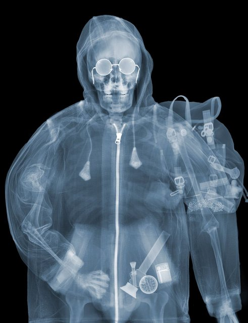 """""""Stoner"""": Carrying something that could get him in trouble. (Photo by Nick Veasey/Barcroft Media)"""