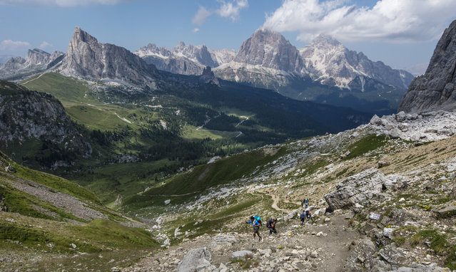 Hikers make their way to the pass at Foro Giau in the Dolomite Mountains near the town of Cortina d' Ampezzo in northern Italy July 15, 2015. (Photo by Bob Strong/Reuters)