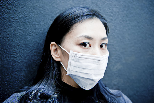 Unhealthy asian woman. The photo was taken at the Tokyo, Japan. (Photo by Marco Maccarini/Getty Images/iStockphoto)